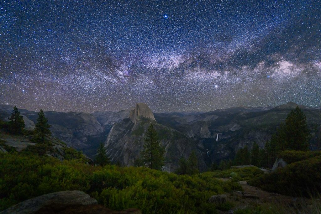 The Milky Way over Yosemite Valley and the popular Half Dome, North Dome, Nevada and Vernal Falls.